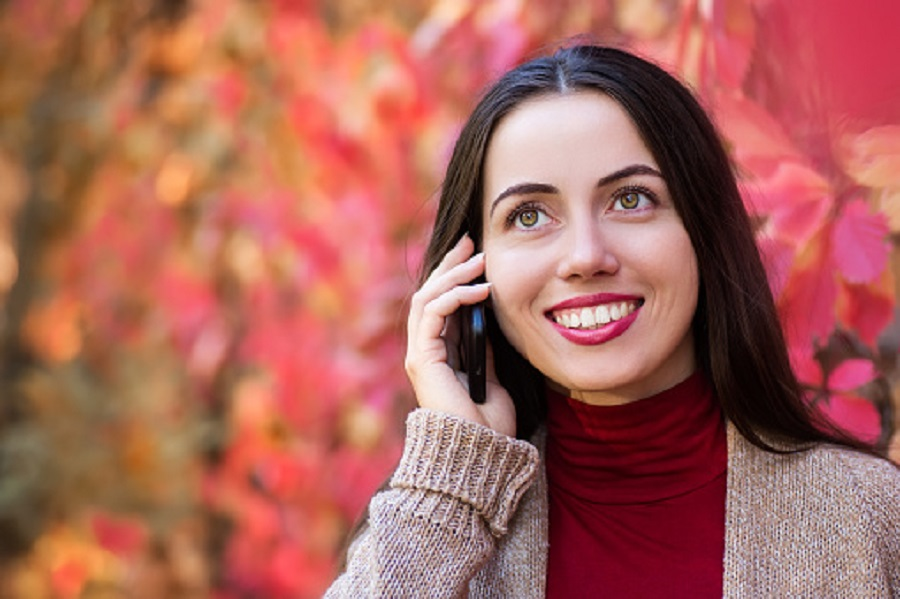 woman talking on phone in autumn park